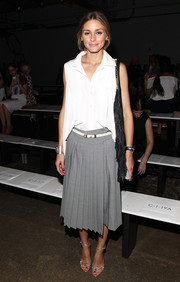 Olivia Palermo paired her top with a stylish pleated gray skirt, also by Tibi.