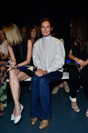 Taylor Tomasi Hill teamed her blouse with bootcut jeans for a laid-back finish.