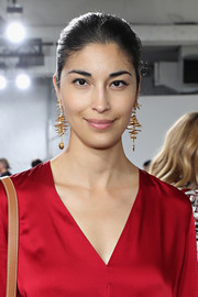 Caroline Issa's gold chandelier earrings provided an ultra-glam finish to her look.
