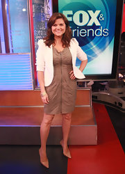 Tiffani Thiessen appeared on 'Fox & Friends' in a zip-front dress paired with sophisticated nude patent pumps.