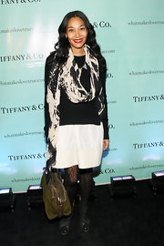 Monique Pean added oomph to her ensemble with a black-and-white oversize scarf.