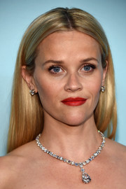 Reese Witherspoon matched her necklace with a pair of Tiffany & Co. diamond studs.