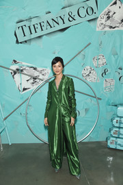 Nicole Warne cut a stylish figure in an emerald satin shirtdress at the Tiffany Blue Book Collection celebration.
