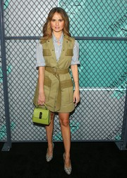 For her arm candy, Debby Ryan chose a lime-green leather purse.