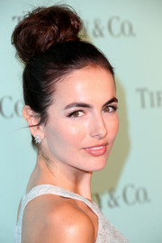 Camilla Belle paired her updo with diamond studs by Tiffany & Co.