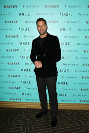 To keep his velvet blazer looked crisp and dapper, Ricky Martin opted for a pair of charcoal gray slacks.