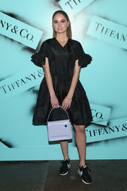 Debby Ryan added a bright spot with a lilac tote by Kara.