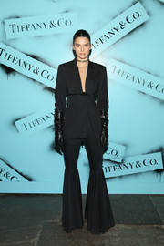 Kendall Jenner looked funky in a flared black pantsuit by Dalood at the Tiffany & Co. Modern Love photography exhibition.