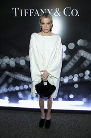 Riley Keough hid her figure beneath an oversized white dress when she attended the Tiffany HardWear Los Angeles preview.