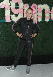 JoJo Siwa matched her top with a pair of studded sweatpants.