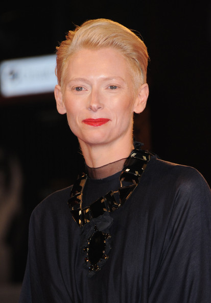 Tilda Swinton Fauxhawk [capitalism: a love story,hair,face,lip,hairstyle,eyebrow,blond,chin,beauty,fashion,forehead,tilda swinton,sala grande,venice,italy,red carpet - 66th venice film festival,premiere,66th venice film festival]