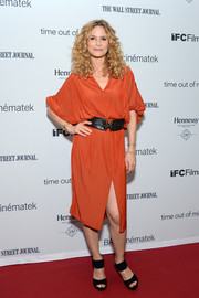Kyra Sedgwick was all about easy elegance in a slouchy burnt-orange dress with a high front slit during the New York premiere of 'Time Out of Mind.'