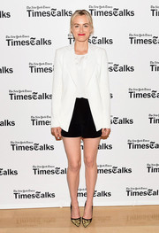 Taylor Schilling teamed her outfit with gold and black Jimmy Choo pumps.