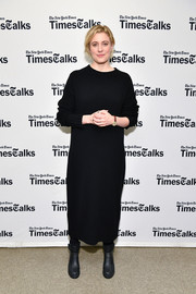 Greta Gerwig sealed off her winter look with black ankle boots.