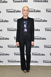 Saoirse Ronan donned a black Coach pantsuit, which she dressed down with a graphic tee, for her appearance on TimesTalks.