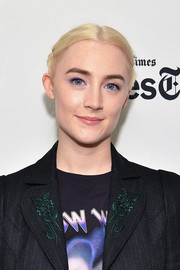 Saoirse Ronan styled her hair into a twisty, center-parted updo for her appearance on TimesTalks.