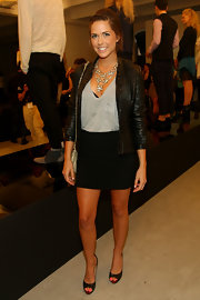 Erin wore a quilted leather jacket with her black mini skirt for the Weiland Spring/Summer show.