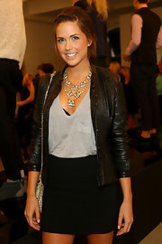 Erin wore a black bandage mini skirt with her leather jacket for the Weiland spring show.