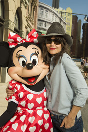 Katie Holmes accessorized with a gray fedora and a pair of cateye sunnies while visiting Walt Disney World.