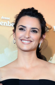 Penelope Cruz attended a photocall for 'To Rome With Love' wearing her glossy mane in a casual ponytail with wispy face-framing tendrils.