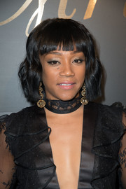 Tiffany Haddish accessorized with a pair of dangling gold spheres by Maxior.