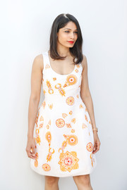 Freida Pinto was summer-chic in a sleeveless embroidered dress by Prabal Gurung at the We Do It Together press conference.