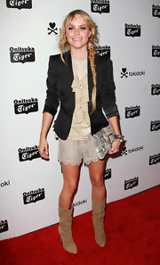 Taryn Manning chose slouchy nude suede boots to pair with her formal shorts look. Her entire look was kept neutral, save for a fitted black blazer she added for contrast.