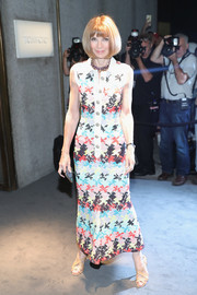 Anna Wintour looked vibrant, as always, in a colorful shirtdress by Chanel during the Tom Ford fashion show.