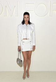 For her arm candy, Adriana Lima chose a chic silver bag by Tom Ford.