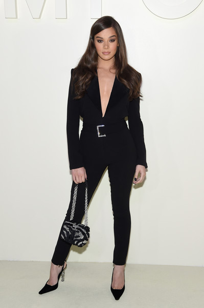 Hailee Steinfeld looked simply chic in a black Tom Ford tuxedo jumpsuit with a bedazzled belt during the brand's Spring 2019 show.