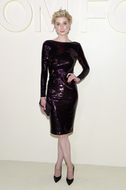 Elizabeth Debicki looked festive in a fully sequined purple dress by Tom Ford during the brand's Spring 2019 show.