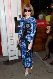 Anna Wintour attended the Tom Ford fashion show wearing a blue print dress and her signature Manolo Blahniks.