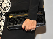 Rita Wilson opted for a classic black alligator skin clutch while attending the Tom Ford Project Angel Food event.