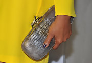 Garcelle Beauvais' silver scale design clutch stood out against the actress' bright yellow cocktail dress.