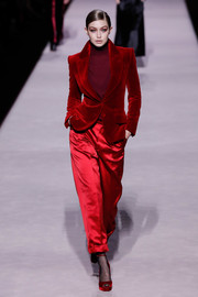 Gigi Hadid looked super chic in a dual-textured red pantsuit while walking the Tom Ford Fall 2019 runway.