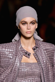 Kaia Gerber walked the Tom Ford runway wearing a dusty-lilac headscarf.