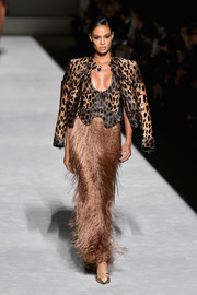 Joan Smalls looked fierce in an animal-print leather jacket layered over a matching low-cut top while walking the Tom Ford Spring 2019 show.
