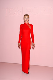 Doutzen Kroes went mega sultry in a red Tom Ford turtleneck gown with a sheer panel down one side during the brand's Spring 2018 show.