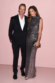 Cindy Crawford complemented her dress with a gunmetal satin clutch, also by Tom Ford.