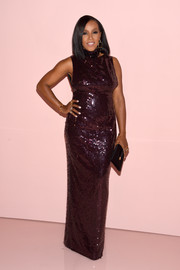 June Ambrose amped up the elegance with a black satin clutch by Tom Ford.