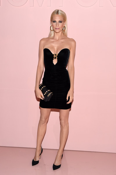 Poppy Delevingne went for edgy styling with a studded leather clutch.