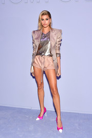 Hailey Baldwin layered a bold-shouldered gold blazer over a chainmail top, both by Tom Ford, for the label's Fall 2018 show.