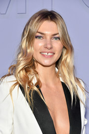 Jessica Hart attended the Tom Ford fashion show wearing her hair in boho waves.