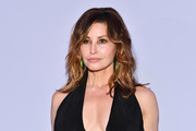 Gina Gershon sported slightly messy, shoulder-length waves at the Tom Ford fashion show.