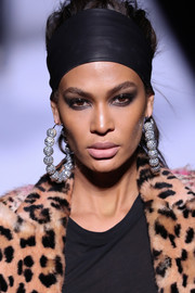 A pair of oversized mirrorball hoops finished off Joan Smalls' look.