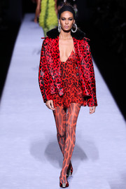 Joan Smalls wrapped up her long, lean legs in a pair of red leopard-print tights.