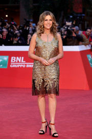 Rita Wilson worked a richly textured, sheer-hem cocktail dress by Prada at the Rome Film Festival.
