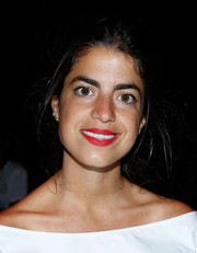 Leandra Medine's bright red lipstick looked striking against her pearly whites.