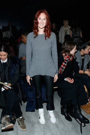 Taylor Tomasi Hill paired her sweater with cropped black leather pants.