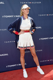 Constance Jablonski layered a blue cardigan over a white crop-top for the Tommy Hilfiger and Rafael Nadal global brand ambassadorship launch.